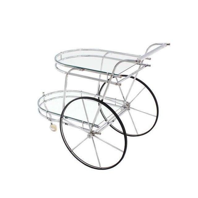 Nice Mid-Century Modern polished chrome and glass rolling bar tea cart.