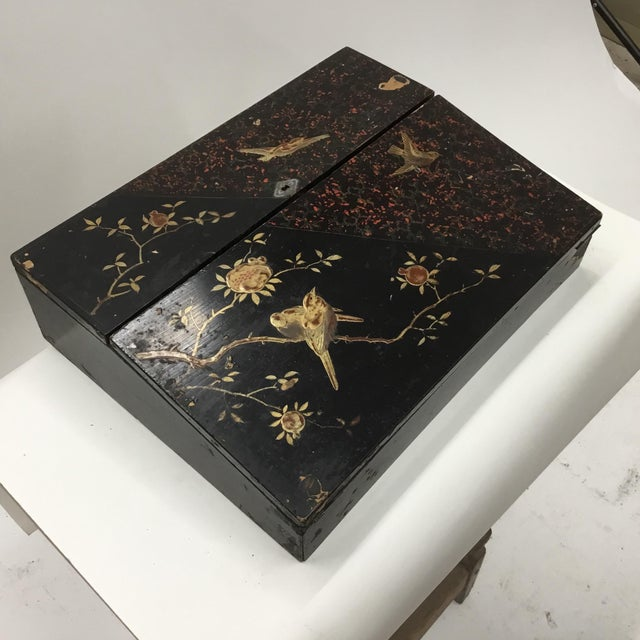 Beautiful lacquer box decorated in red and gold with birds on flowering tree branches . Fitted interior , velvet lined...
