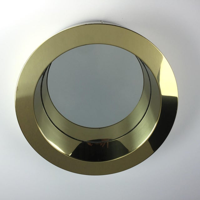 An Eyecatching 'Porthole' Mirror By C. Jere In Brass Finish