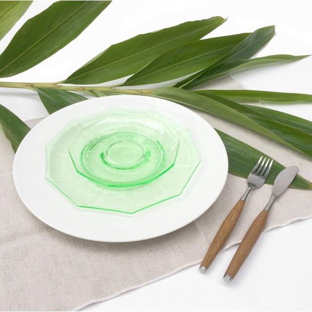 A great set of antique, clear green, uranium vaseline glass plates. This set includes 6 octagonal luncheon plates and 6...