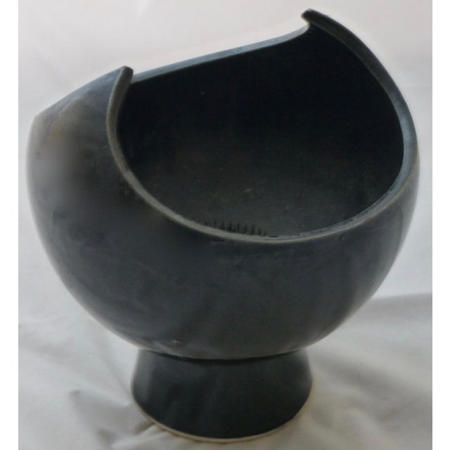 Unusual form to this mid century modern vase, we love the black glaze and of course, it's wings. There is a flower frog...