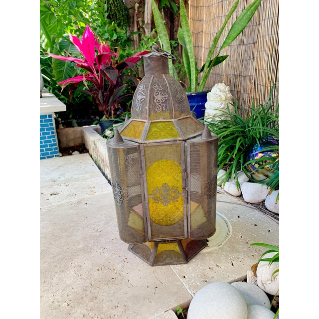 Vintage Moroccan floor or hanging candle holder oriental lantern. Beautiful craftmanship with dainty details, colored...