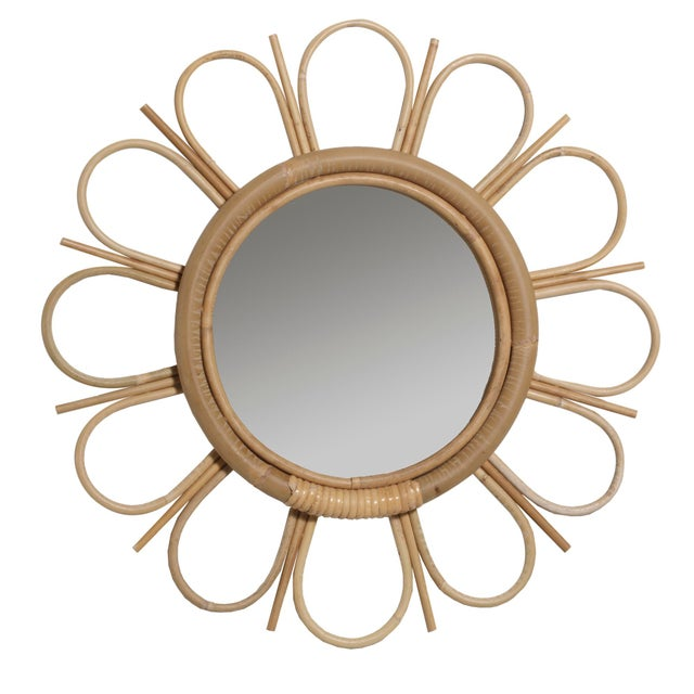 Natural rattan and leather wrapped pomegranate flower mirror with art deco flare.