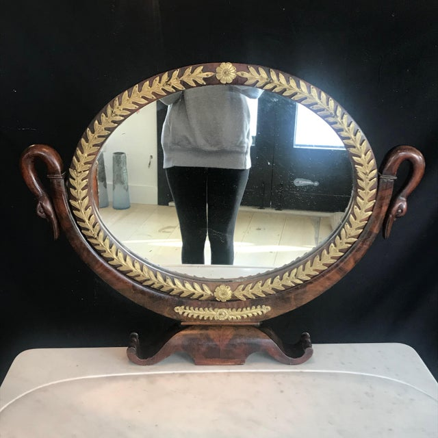 This exceptional French 19th century Empire mahogany dressing table is complete with its original mercury glass mirror and...