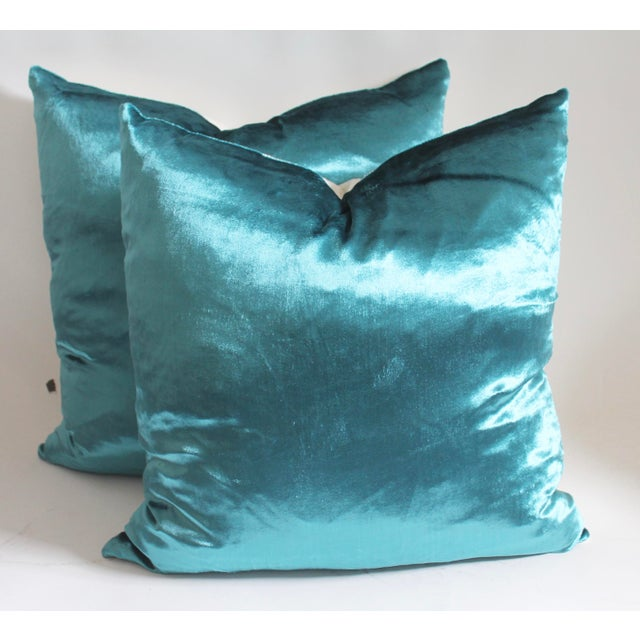 Pair of Aqua velvet with linen backing, down and feather insert and zipper closure on bottom.