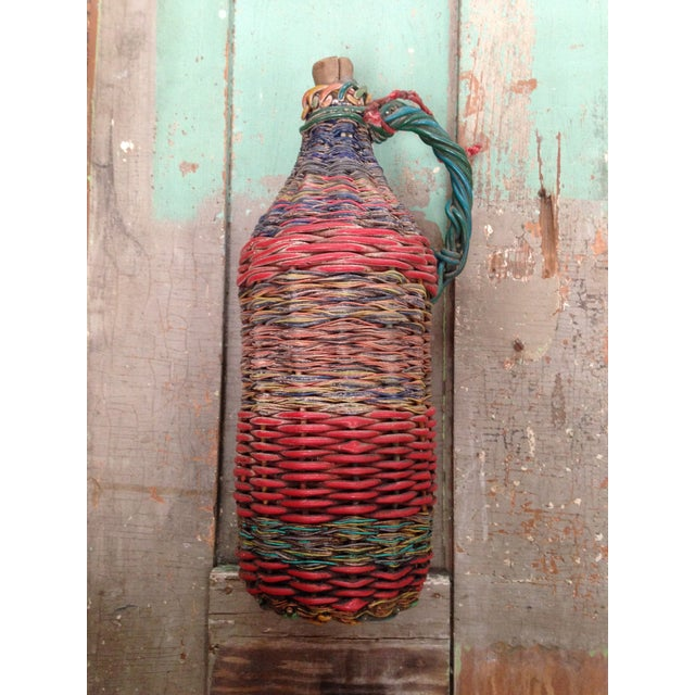 This bottle was imported from Eastern Europe. It was created between 1910 and 1950 by miners who repurposed multi-colored...