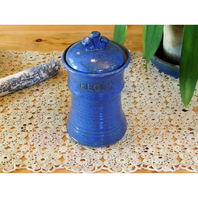 This is the sweetest ceramic jar! It is perfect to store flour on your kitchen counter top. Handmade and signed on the...