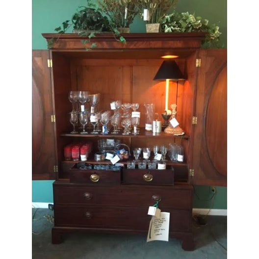 This is a wonderful 19th Century, Mahogany English Linen press. It's perfect for storage! Could be used as a bar or for...