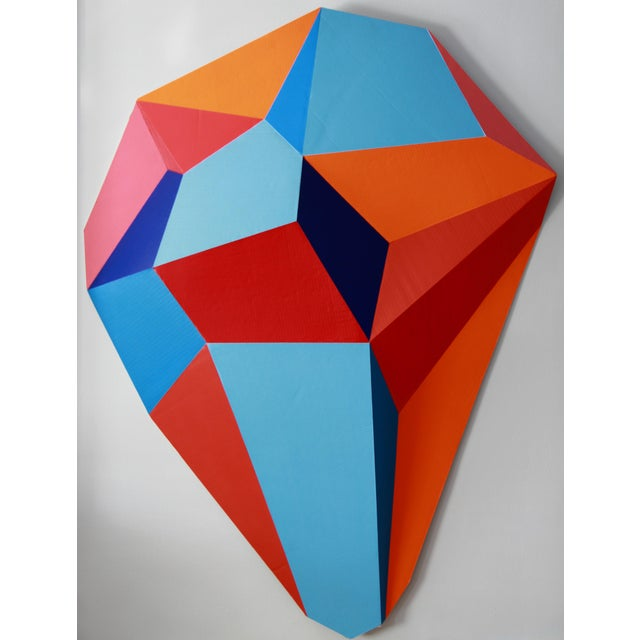 Wall hanging sculpture with cardboard, acrylic paint. The piece is by artist Sassoon Kosian.