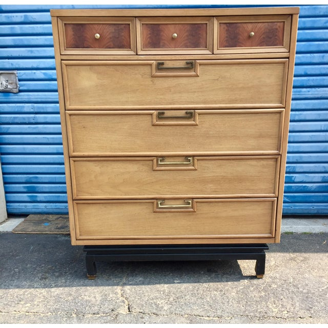 This is a beautiful vintage American of Martinsville highboy. The piece is made of ash wood and features brass pull...