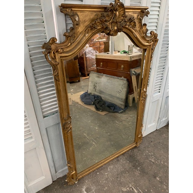 Beautiful 18th century one of a kind antique Napoleon III period mirror with original gold leaf and original glass. This...