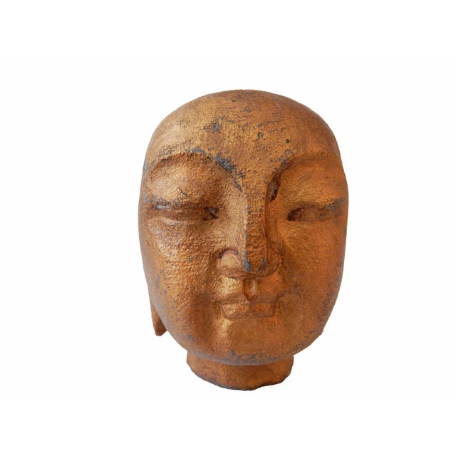 Superb small hand carved of one piece of stone asian Buddha head with peaceful face .
