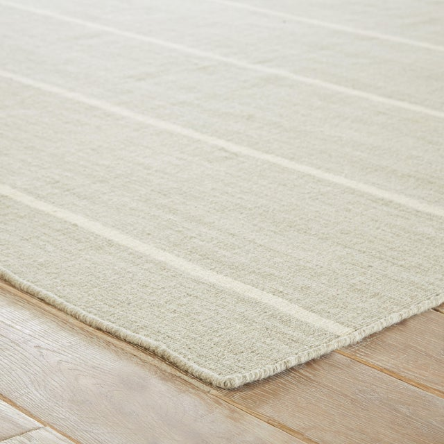 Classic with a bold stripe, this coastal gray and white flatweave area rug lends traditional charm to any space. This...