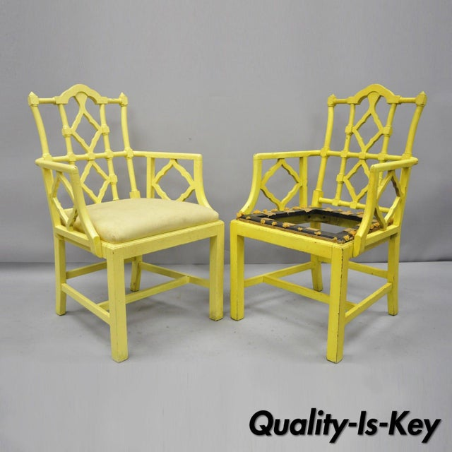 Pair Fretwork Chinoiserie Hollywood Regency Chinese Chippendale Armchairs. Item features open fretwork back and arms,...