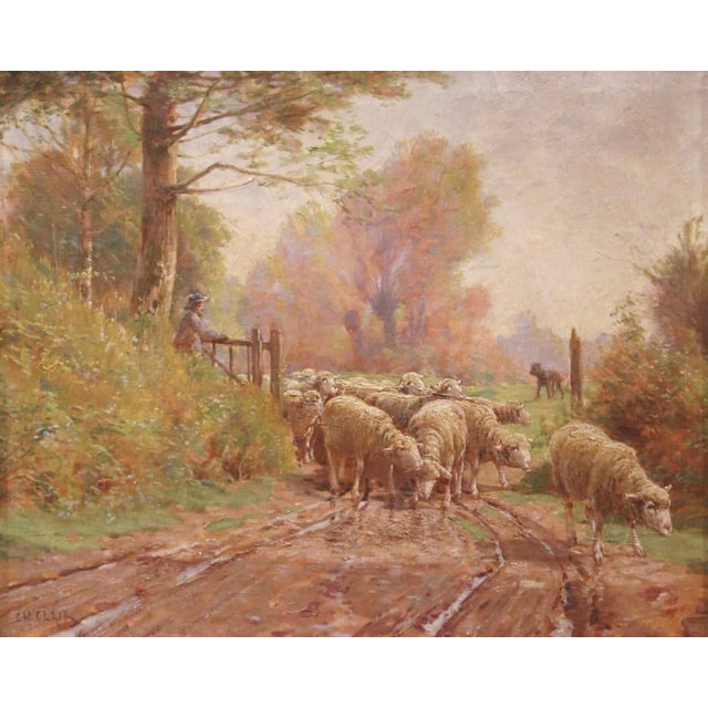 Set in the original carved gilt wood frame, this antique oil on canvas was crafted in France, circa 1880. The pastoral...