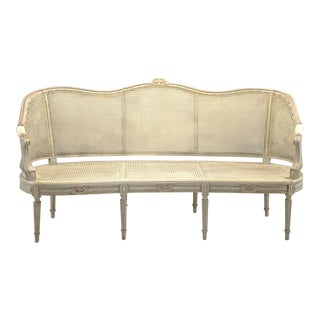Painted Louis XVI Style Large Caned Settee With Original Cushion For Sale