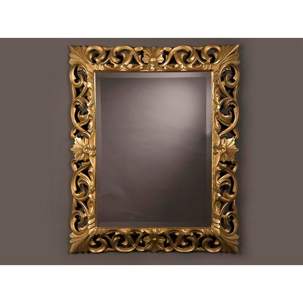 A beautiful gold leaf Baroque style frame from France c. 1875 enclosing the original bevelled mirror glass. The intricate...