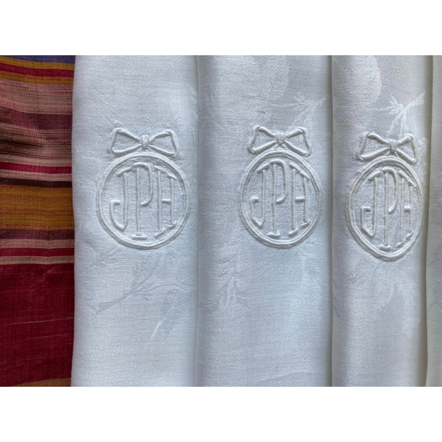 A set of 8 large European style linen damask napkins, starched and pressed and ready to serve