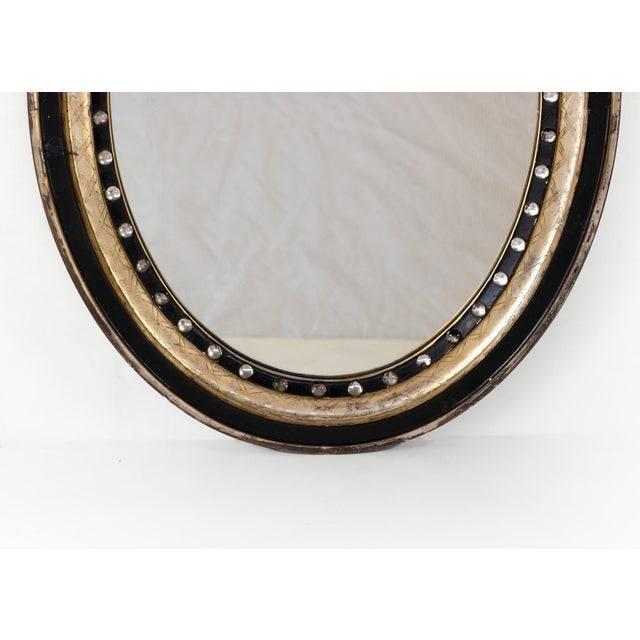 Late 19th Century Irish Oval Mirror With Moulded Parcel-Gilded and Ebonized Frame, Applied With Mirrored Glass Facets, Circa 1890 For Sale - Image 5 of 6