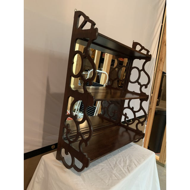 Antique Chippendale carved mahogany 3 tier wall hanging display rack with mirrored back. The shelves gradually get larger...
