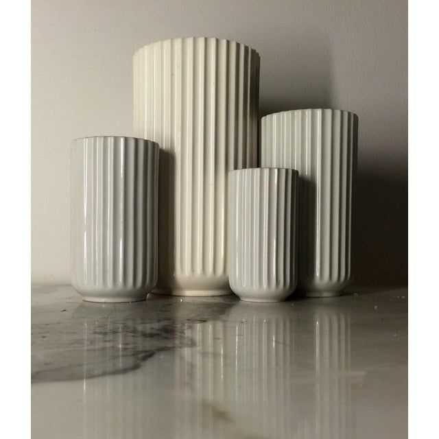 "This is a set of 4 Lyngby of Denmark ribbed porcelain vases from the 1960s. Dimensions: 8.25""height x 4.5""diameter 6"" x..."