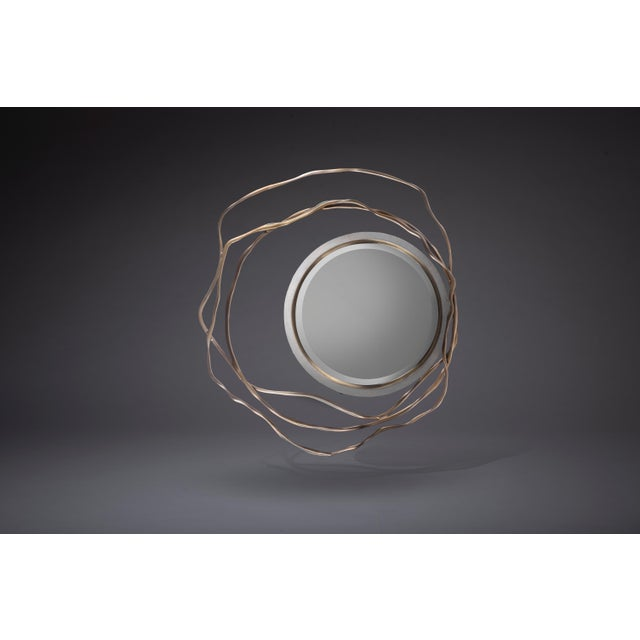 The Dargelos Mirror is a statement piece with its ethereal inspired roots. The intertwinement of the twisted bronze-patina...