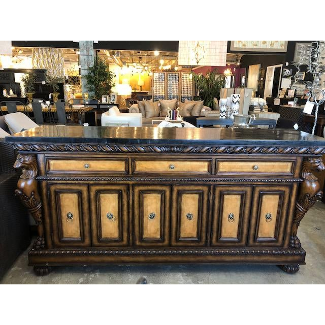 This is an amazing traditional style buffet with lion motif on the corners and pulls. The top is faux marble which give...