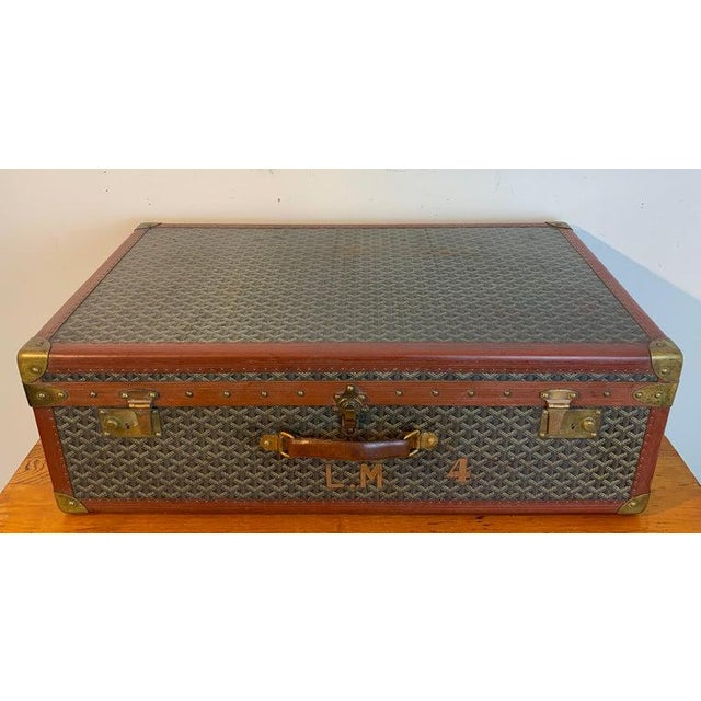 """Vintage Goyard Hardcase trunk on iron stand, in two parts. The case alone measures 31.5"""" x 19"""" x 10"""" H. The stand measures..."""
