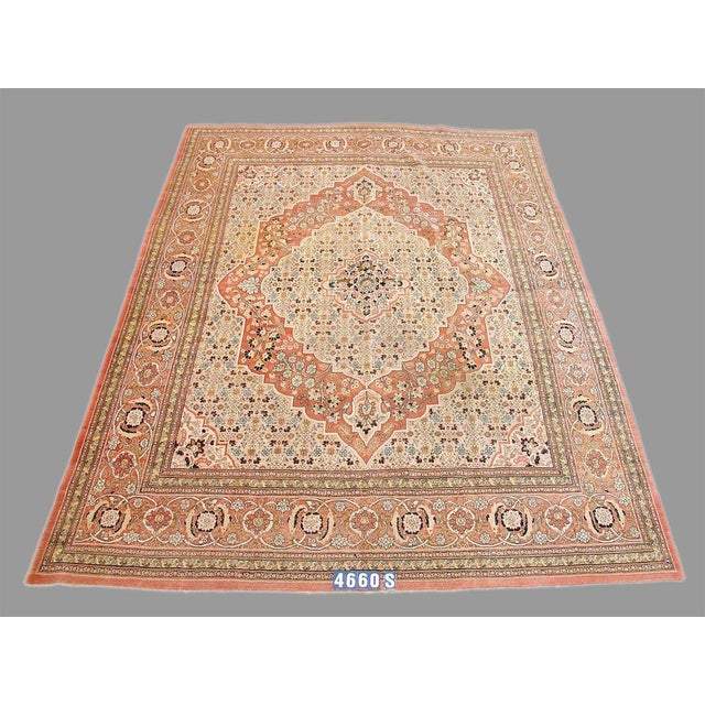 An elegant Persian carpet, well balanced with a central medallion and soft colors. Hues of ochre, ivory and cream.