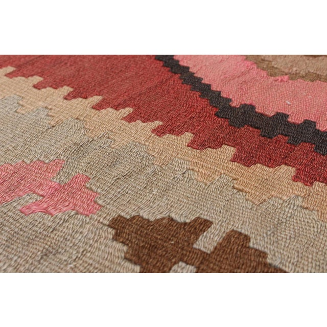 Handwoven in Southwestern Iran, Kashkoli tribal kilims have geometric and small motif patterns that work well in...