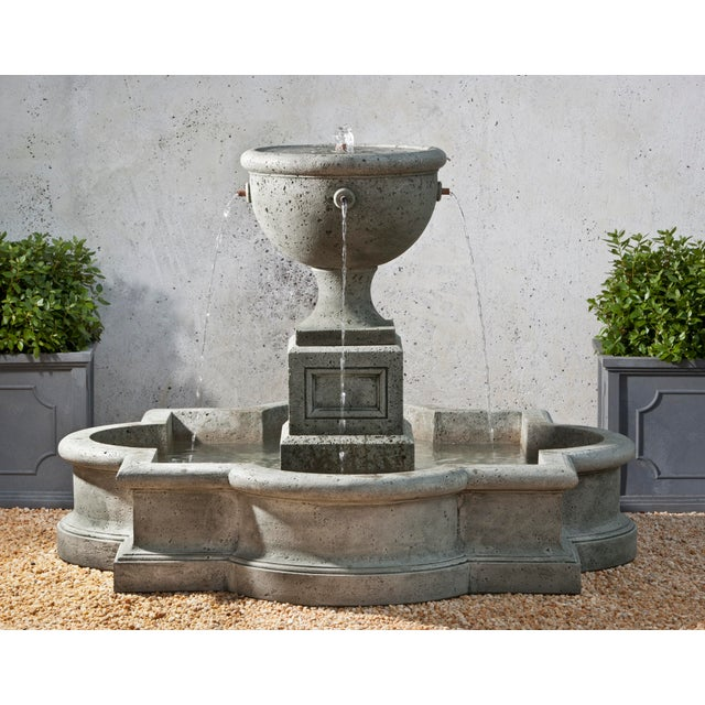 A garden fountain with a central urn, in an Alpine Stone finish.