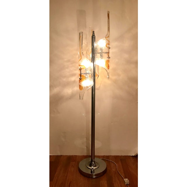 Vintage Italian mid-century floor lamp with 3 hand blown tubular clear and amber Murano glasses, mounted on chrome frame /...
