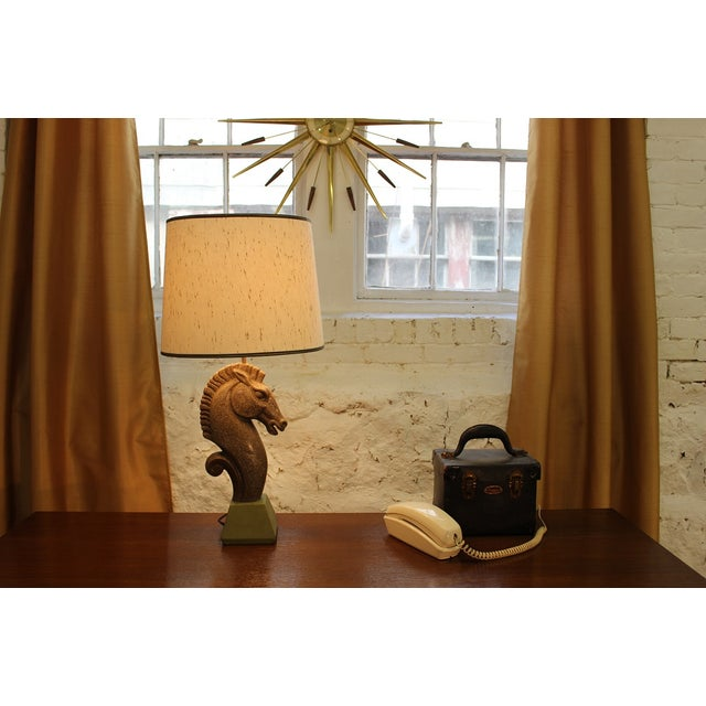 This beautiful ceramic lamp features an equestrian shaped body on a square base. It is coming to you from the 1960's and...