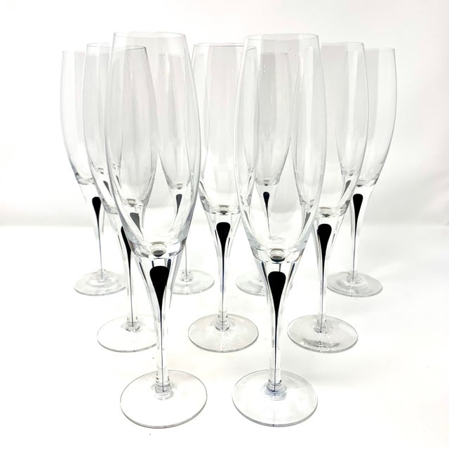 "Set of 9 ""Intermezzo"" crystal champagne flutes by Erika Lagerbielke for Orrefors of Sweden. The flutes feature a delicate,..."
