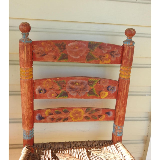 Pair of vintage rustic Mexican folk art hand painted chairs with woven rush seats. In a soft worn red with flowers. Old...