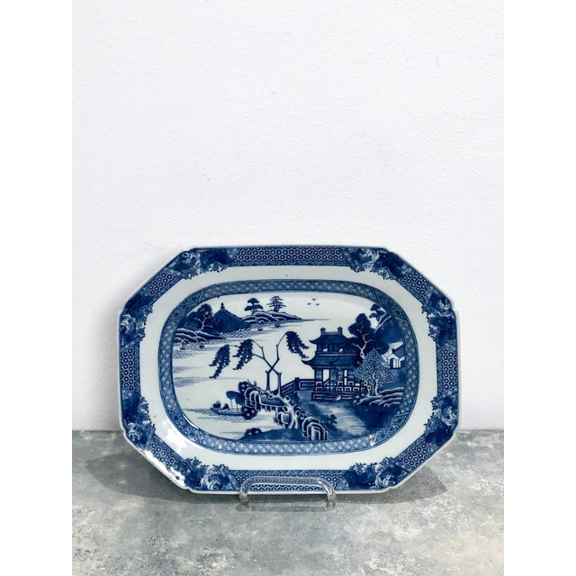 A pair of Chinese blue and white octagonal platters, 18th Century. Plate stands for display only.