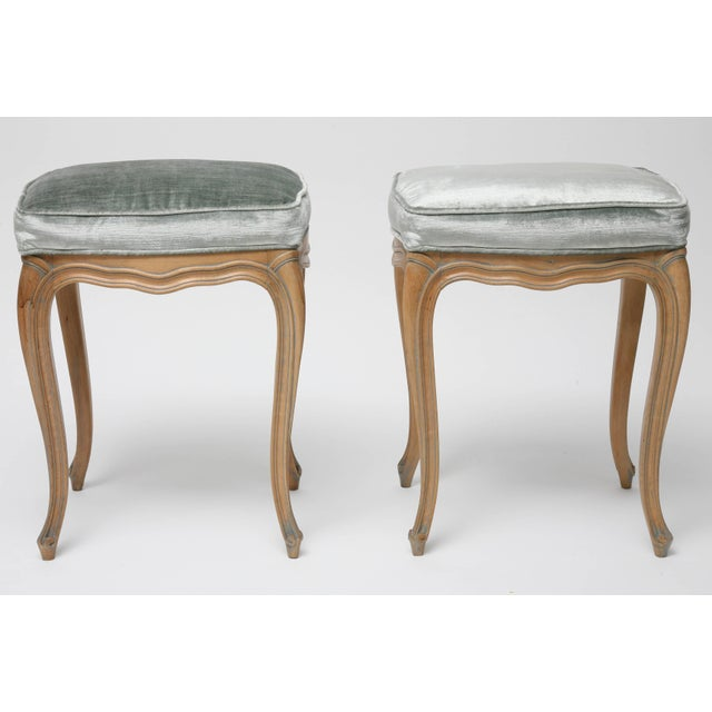 This pair of charming Louis XV style stools were recently acquired from a Palm Beach estate and have a natural beechwood...