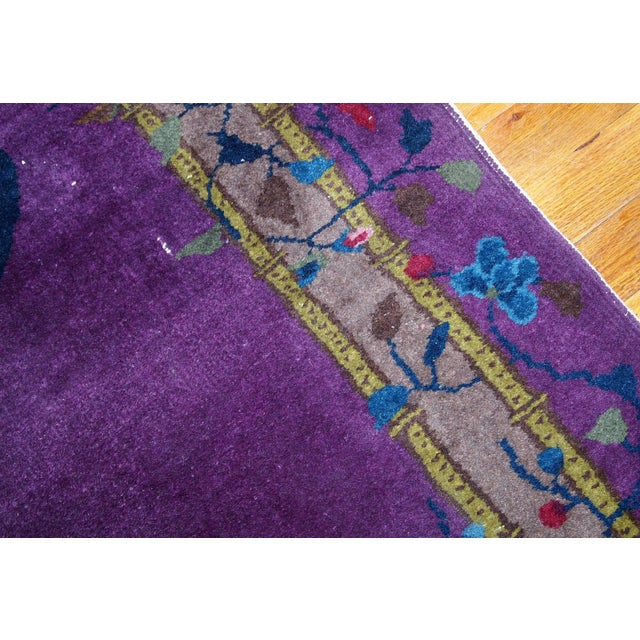 Antique handmade Art Deco Chinese rug in purple shade. It has been made in wool in the beginning of 20th century....