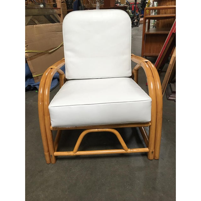 This rare rattan reclining lounge chair with arched 1949er arms. Custom cushions C.O.M. (Costumers Own Material) are...