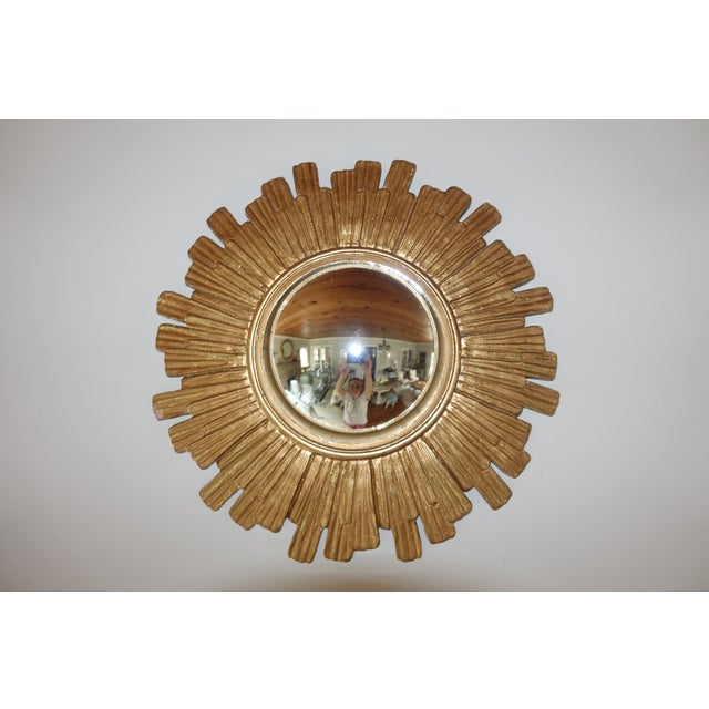 Beautiful vintage sunburst mirror with gorgeous gold patina; not a reproduction. The sunburst frame is unbranded and is...