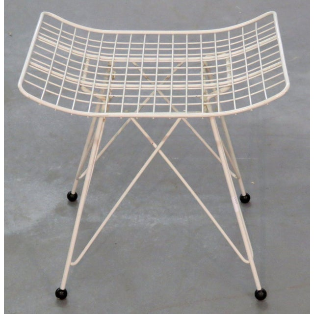 Great iconic design, attributed to Charles and Ray Eames. Paintined white. Cushion not included.