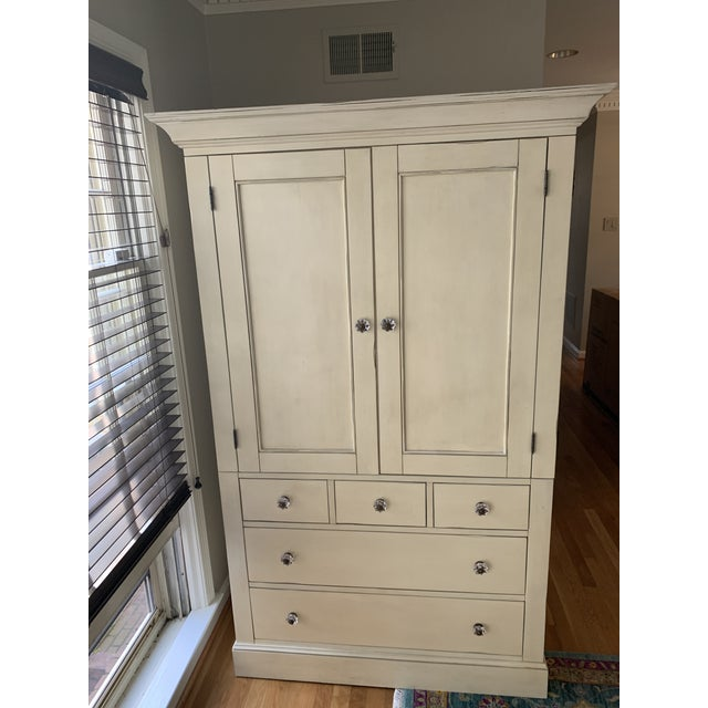 Pottery Barn Charlotte armoire in antique white (creamy off-white with warm undertones). Knobs have been replaced with...