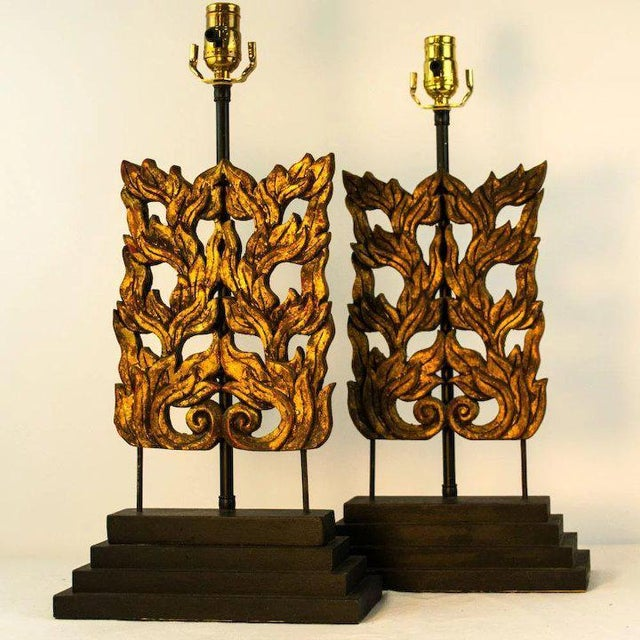 These late 19th century hand carved Chinese flame fragments have been mounted to black lacquer stepped bases and are...