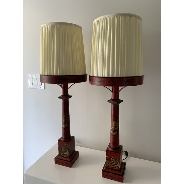 Chinese table lamps with lantern type shade. These deep red metal lamps are painted with asian landscape and decorative...