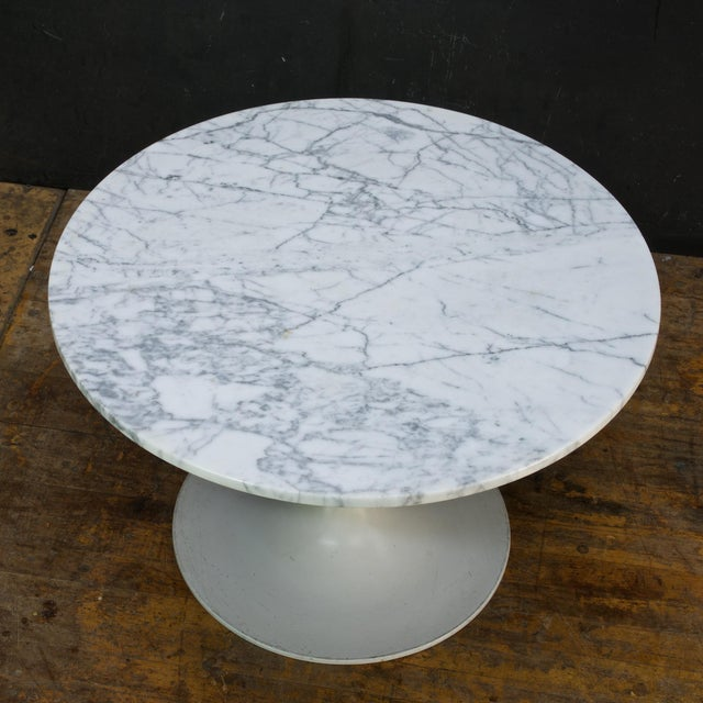 Mfg.'d by Burke Inc., with a thin profile, and highly figured Carrara marble top. No chips, no cracks.