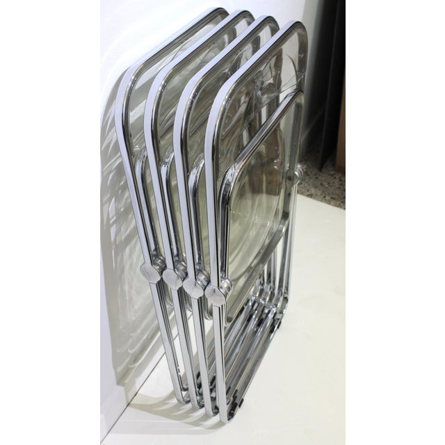 Italian Design Plia Folding chairs in Lucite and chrome by Casselli from a Palm Beach Estate. Size opened is 18.25w x 18 d...