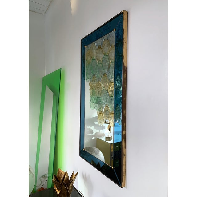 Mirror blue with brass frame by Cristal Art. Famous manufacture like Fontana Arte