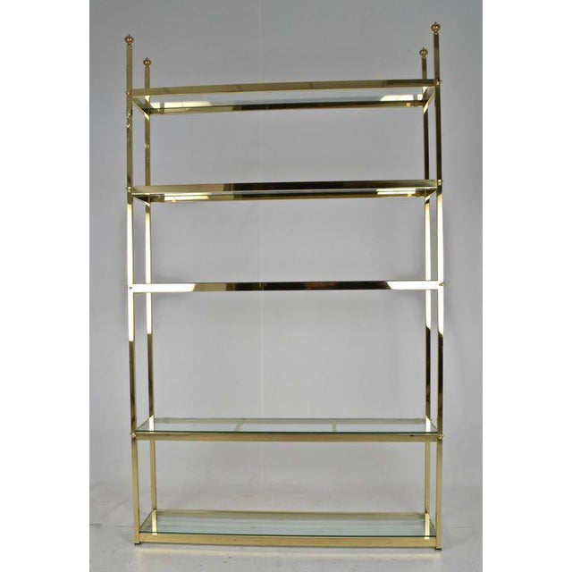 """Solid brass and quality construction, a large size étagère at 49"""" wide. Heavy glass shelves. Newly polished and lacquered...."""