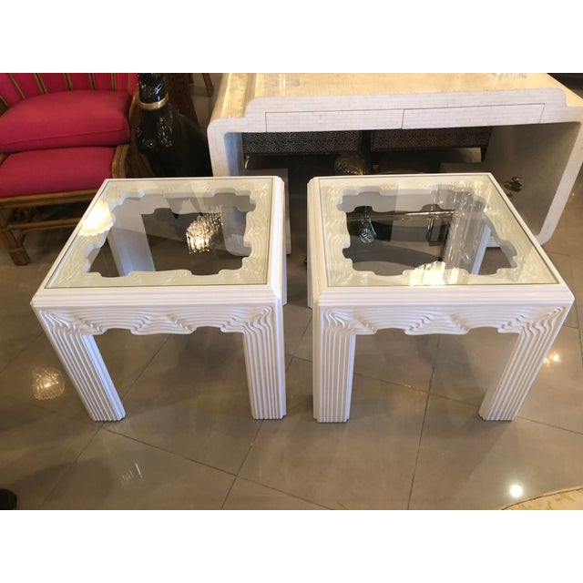 Pair of vintage end side tables. Newly lacquered in a white gloss. New glass was cut for the tops. These have the most...