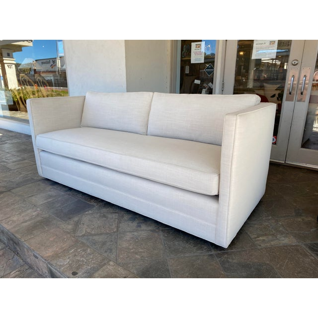 Design Plus Gallery presents a Miles Talbott Custom Landry Sofa with White Crypton Upholstery. Frame is constructed of...